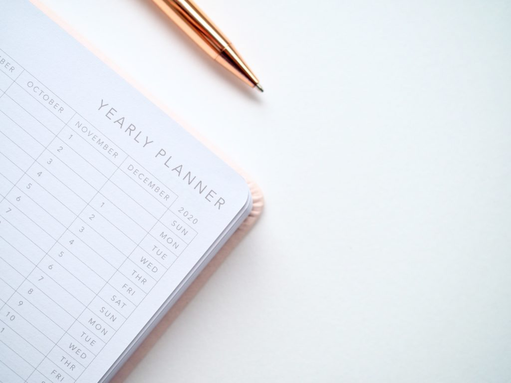 Photo of yearly planner with pen