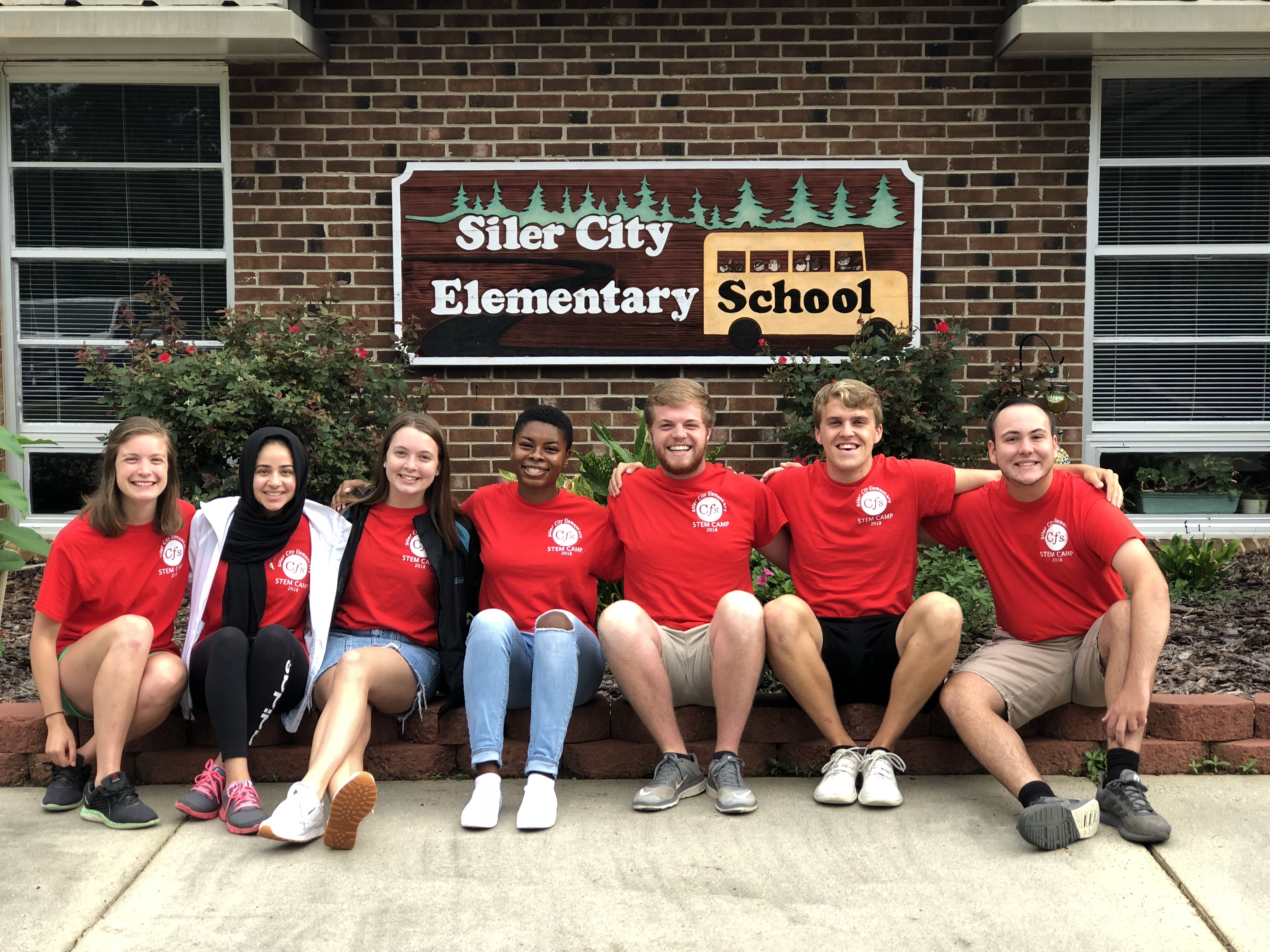 NC State University student counselors. all are wearing matching red shirts.